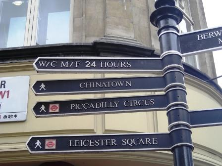 street sign in london directions to chinatown