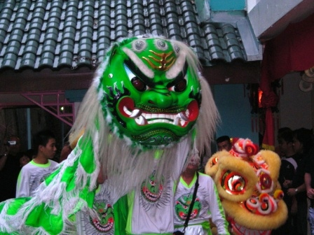 green lion and lion dance