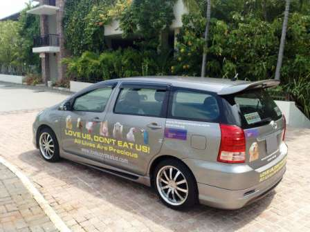 A car in singapore decorated with a giant size decal note regular size decal is 24 5 cm x 11 cm 4 3 x 9 8 inches