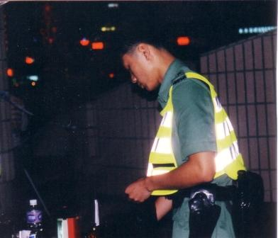 police changing insignia at mid night of hong kong handover